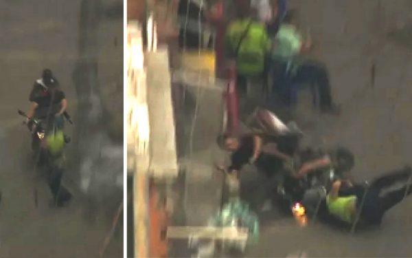 Flagrante: bandidos com fuzil em moto atropelam homem com criança no colo