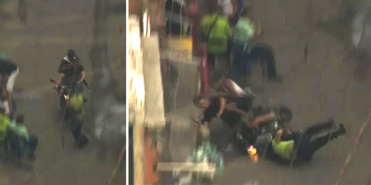 Flagrante: homens com fuzil em moto atropelam homem com criança no colo